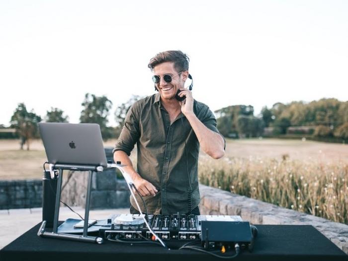 DJ playing birthday party smiling