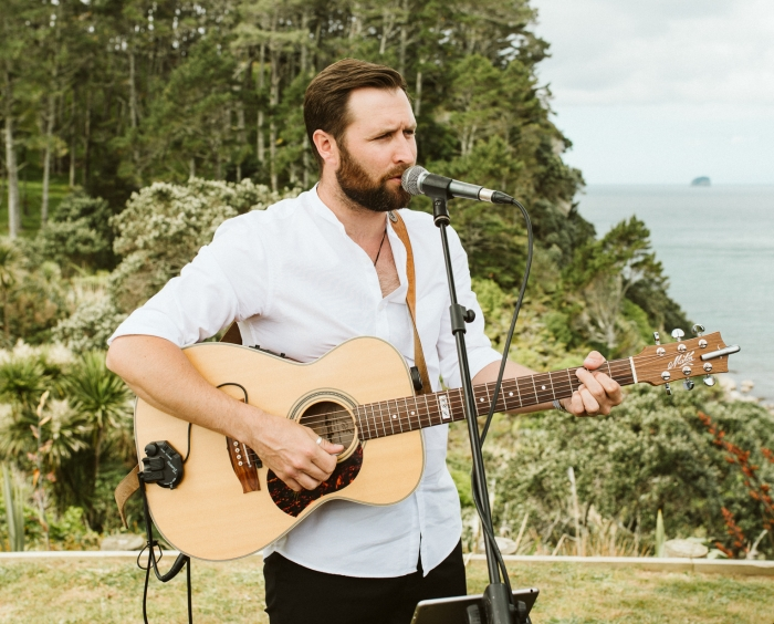 Wedding Musician singing and playing guitar